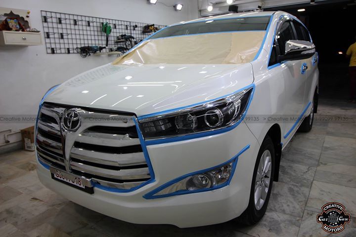 Toyota Innova Crysta got ''Ceramic Glass Coated''  by us At ''Creative Motors''  --> 3year Protection in 3hours  *Dont Forget to check ''PAINT ENHANCEMENT'' Captured by PRO Camera in the Photos...  Minor Scratches Removed and will become easy to clean & Maintain, it also protects from Harmfull UV Sunrays and Gives Additional Gloss  #cardetailing #highendcardetailing #ahmedabad #ceramiccoating #glasscoating #Original #Permanent #protection #India #Super #worldno1 #superhydrophobic #Diamond #proud #proudmoments #Volvo #Porsche #Mercedes #Ahmedabad #Rajkot #Qualityovereverything #Toyota #Innova #Crysta  Company Centres at :  1. Groud Floor, L-32, Guj H.Board, Opp. Pride One Complex, Amin Marg, Rajkot.  2. GF 1,2,3 Urvashi Complex, Nr. Calcutta Motors, Mithakhali Six Roads, Navrangpura, Ahmedabad.  3. Plot no. 2 , Nr AFS Cars, Opp. Karnavati Club , SG Highway Ahmedabad.  Social Media - Live Stories : Instagram @ creativemotors Snapchat @ creativemotors  For More Info -  Dhwanit Patel 99099 99135