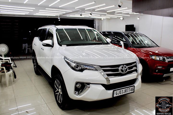 #Toyota #Fortuner #White got the #Best #Ceramic Treatment at ''#Creative #Motors''    #Ceramic Coat #Benefits:   ♦Gives Additional Gloss/Shine  ♦Protects Paint from Fading ♦No Ageing Effect  ♦Removes Hairline Scratches & Water-spots  ♦Water & Dust Repellent   ♦Easy to Clean & Maintain  ♦No need to Wax and Polish again  ♦Scratch Resistant upto 9H Hardness  ♦3 Year  Protection in 3 hours    Call or Whatsapp : +91 99099 99135    Follow us on instagram: www.instagram.com/creativemotors    Address:   Creative Motors Ahmedabad     GF 1,2 Urvashi Complex,  Nr. Calcutta Motors, Mithakhali Six Roads, Law Garden Road, Navrangpura, Ahmedabad       9909999135     #creativemotors #bikes #bikers #Cars #carspa #microdetailing #ceramiccoatings #coatings  #glasscoatings #waterrepellant #scratchproof #minicooper #supercars #Rajkot #ahmedabad #Jeep #compass #qualityovereverything