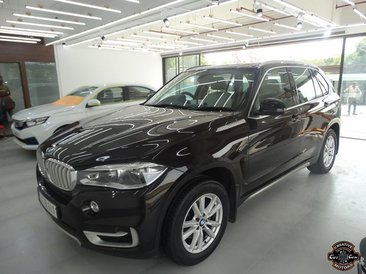 BMW X5 got Ceramic Coating  Ceramic Coating Work Started at our New Showroom - Creative Motors Thaltej  #Benefits: - Scratch Resistant - Easy to Clean & Maintain - High Glossy Shine - Highly Durable  Call or Whats App - +91 99099 99135  Address:  'Creative Motors Thaltej' Nr Baugban Party Plot, Off Sindhubhavan Road  Thaltej Shilaj Road, Thaltej  #carservices #carspa #carwash #creative #motors #details #detailsmatter #luxury #luxuriouscars #shine #automobile #standout #live #pictures #reality #ahmedabad #carlove
