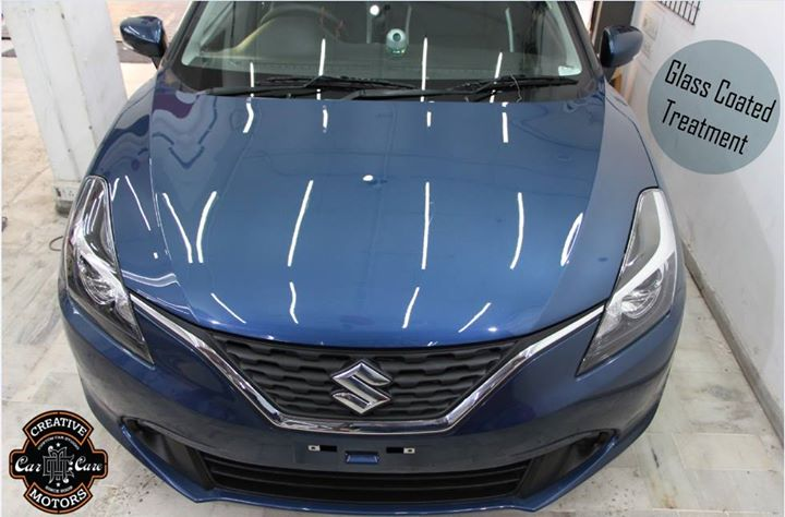 Gloss...It's easier to get this glossy and better than new car look after our Glass Coated Treatment.  This new Maruti Suzuki Baleno Wish had gone through our Glass Coated Treatment and emerged